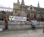 9 Michael Tristi and Mical with their banners outside Parliament