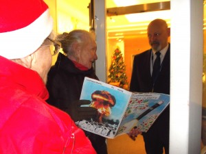 Two Muriel Lesters deliver a Christmas card to Lockheed Martin