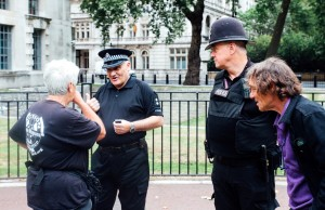 2 Angie talking to police with Bernard looking on
